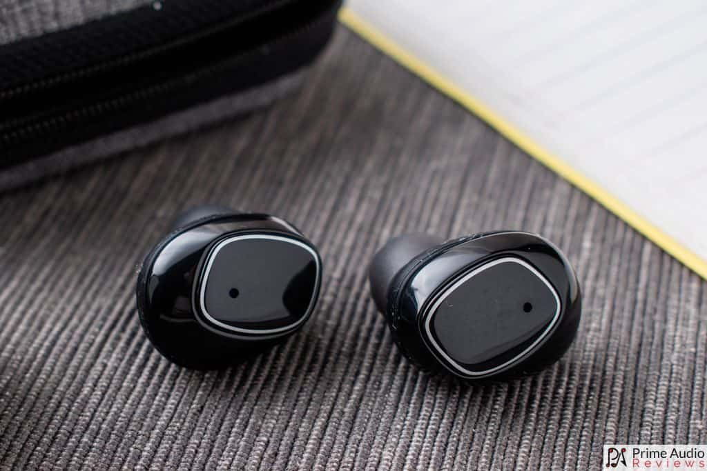 Capacitive touch buttons on earbud faceplates